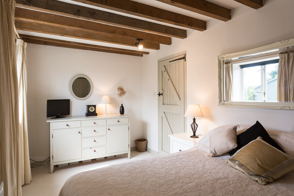 Barn Bedroom with beamed ceiling